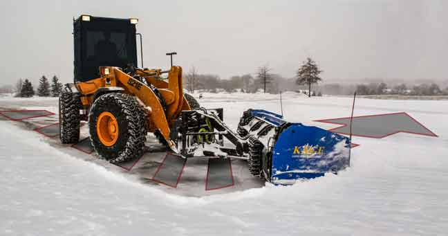 snowstorm wheel loader plow turn